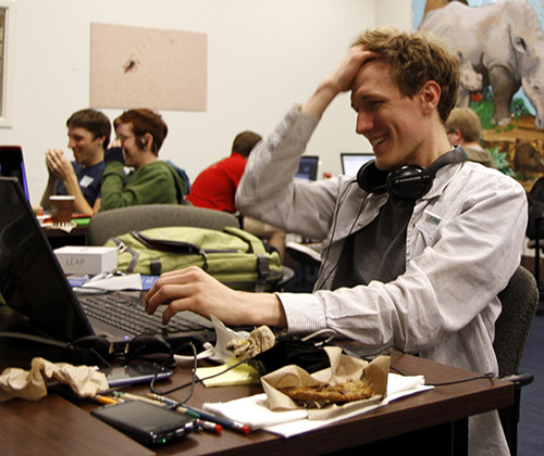 Developer Stephen Meyer struggles to ignore a half-eaten cookie.